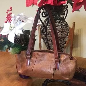 Tooled fossil leather purse